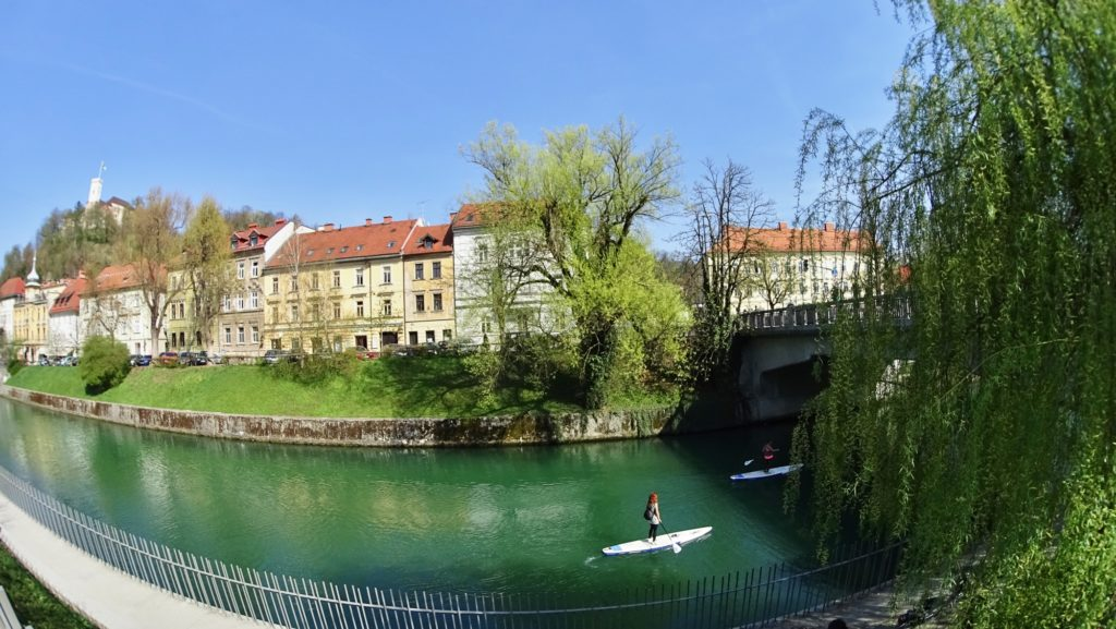 Girls enjoying stand up paddle in Ljubljana