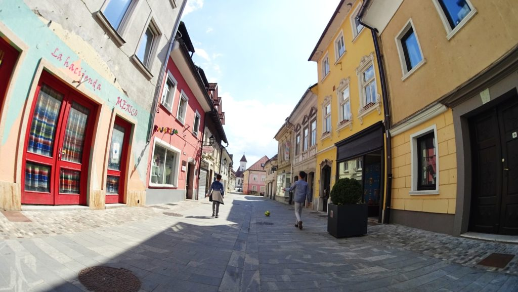 Noys playing football in the old town of Kranj